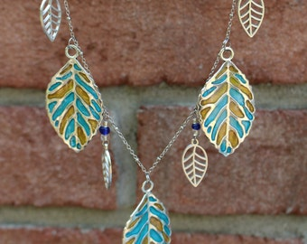 Turquoise and Gold Leaf necklace and earring set.