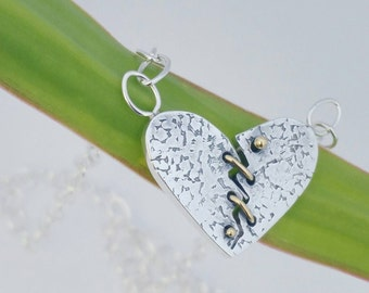 Sterling silver 18kt gold mended heart necklace