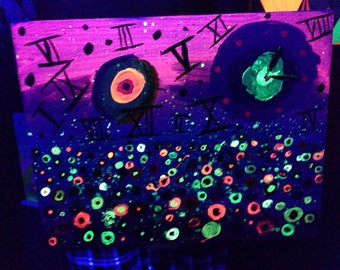 Illusion of time. Blacklight reactive acrylic painting