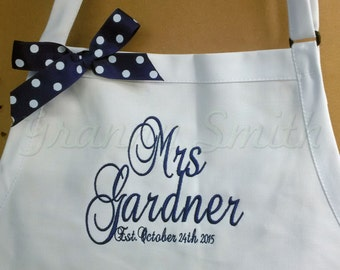 """Her new last name apron with Est date with or without bow. 24""""L x 28""""W professional 3 pocket full bib. Nautical wedding colors. Navy blue"""