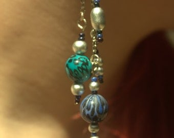 Long silver chain earrings with blue and purple beads