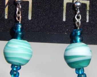 Green swirled glass bead french hoop earrings