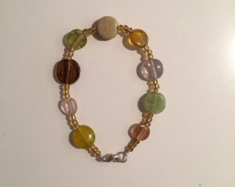 Earth tones,glass,beaded,bracelet,silver clasp,glass beads,gold,green,brown,pink,yellow,ochre,amber,neutral,handmade,jewelry,unique design