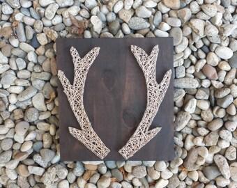 String art antlers on wood board
