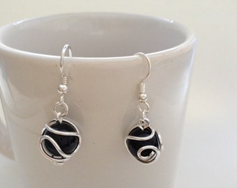 Fine silver wire wraped around black onyx bead dangle earring.