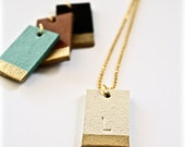 """Leather """"gold"""" dipped personalized tag."""