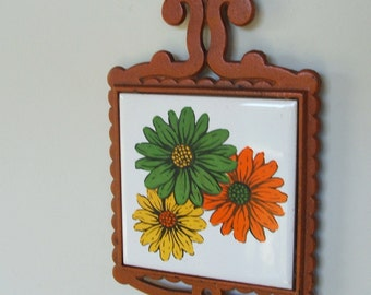 Vintage Cast Iron and Ceramic Tile with Retro Flowers