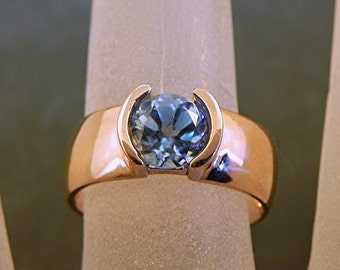 AAA Round Swiss Blue Topaz   6.10mm  1.18 Carats   in 14K rose gold ring. 1015