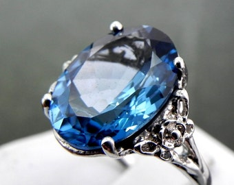 London Blue Topaz   16x12mm  10 Carats   in an Antique styled Floral 14K white gold ring