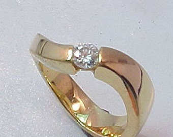 Tension set 14k yellow gold Solitaire Engagement ring with .30 carat Diamond.  9 grams