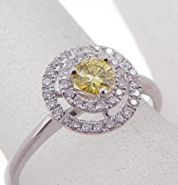 Stunning .26 carat Round Brilliant cut Natural Yellow Diamond in a double Halo 18K white gold ring (.46CTTW)0956 MMM