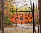 Personalized Family Name Sign - Custom Carved Redwood - Pine Tree Colored Campfire Graphic - Wood Campsite Sign includes sign holder