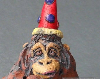 Ape in a Party Hat Whimsical Ceramic Sculpture