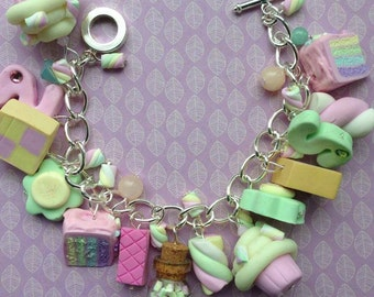 Pretty loaded Pink themed sweet Charm bracelet personalised