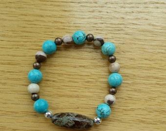 Turquoise and earthtone beaded bracelet.