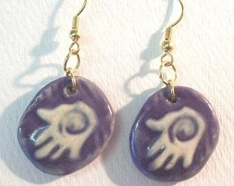 Purple creative hands earrings.
