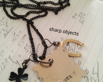 LUCKY - mens stamped tag, clover & horseshoe metalwork talisman charm and black chain NECKLACE