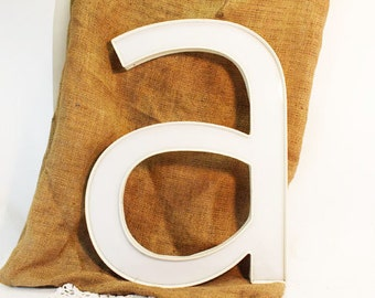 Letter A, lower case 'a', white plastic