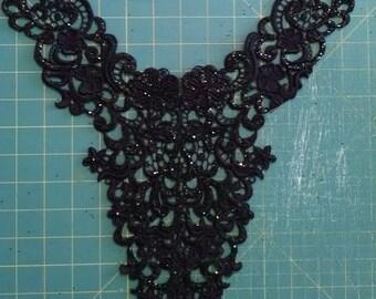 Large lavish black lace applique