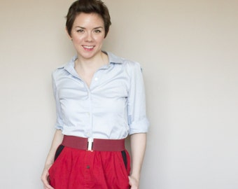 Clearance - small, short red skirt with black pockets, black elastic waistband with buttons down the front