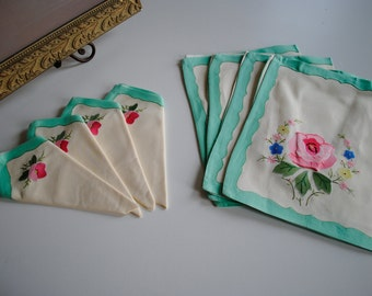 an adorable set of four vintage placemats and matching napkins. mint white muticolored floral print.