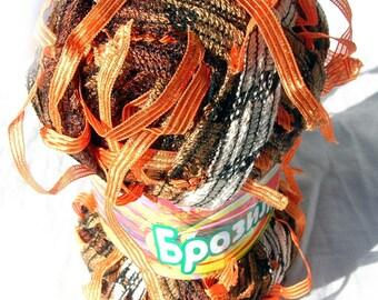 Yarn with tassels. Yarn Brasilia in oranges. Unique ladder yarn with ribbon pendants tassels.