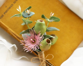 Buttonhole, Boutonniere for groom, groomsmen, men.  Wedding, special occasion buttonhole. Flowering Eucalyptus, gum blossom, gumnut, foliage