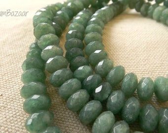 Faceted medium green rondelle shape stone beads, 16 inch strand