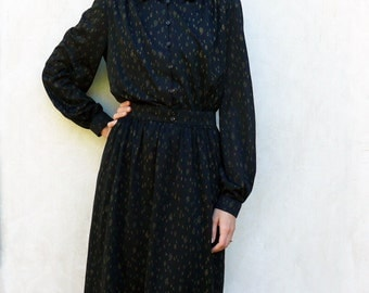 """Vintage long sleeved dress - black with gold paisley design . . . . . . . . . . . . . """"Like"""" our fb page for 10% discount"""