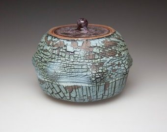 blue brown sugar bowl lidded jar pot cracked surface