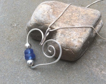 Sea glass jewelry,  Blue sea glass and sterling silver beaded heart necklace
