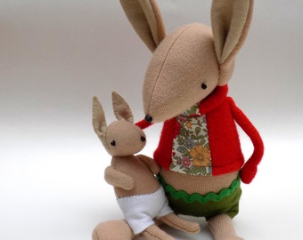 Fawn Woollen Rabbit with detachable baby kit in furry carrier - Handmade mother and child wearing felt pants.