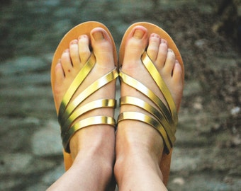 Luxury gold womens sandals. leather summer flats