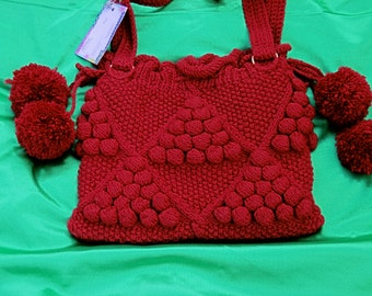 Ladies medium hand bag with long shoulder strap.