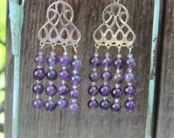 Beaded chandelier earrings with amethyst beads and silver.  Make a statement!