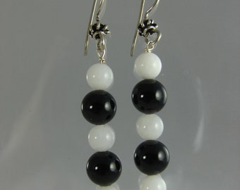 Polished onyx and bleached coral on French wire with Bali silver filigree bead