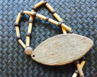 THE CASAGRANDE NECKLACE -  Simple.awesome.mini bambu tubes.coconut shell.pendant.drop.