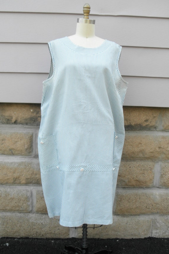 Light Blue/White Striped Cotton Seersucker Dress Style: LM Sleeveless bodice Irremovable poly silk sash Crinoline layer & lining within Zipper w/ tie back sash closure Tea length Swea Pea & Lilli M Made in the USA Matching sold separately.5/5(4).