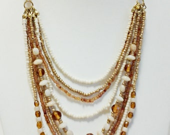 Beige, Bronze and Amber Multi Strand Beaded Necklace / Bib Necklace.