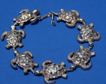"BRACELET, SEALIFE, Sterling silver #925, 7 large Turtles,  diamond facet cut, size 8"",security clasp.circa 1990's"