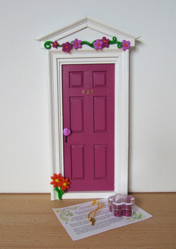 Bright pink fairy door with pink and purple flowers let for Pink fairy door