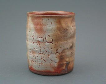 Cup, wood-fired stoneware w/ shino and natural ash glazes