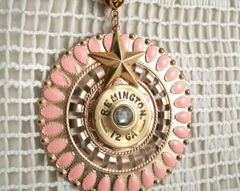 12 Guage Remington Necklace with  pink enamel decor Smoky crystal center