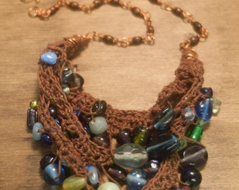 Beautiful Brown Mixed Blue Green Glass Bib Necklace on Copper wire - Daughter of the Beach - Crocheted Cotton with Lampwork Glass Beads