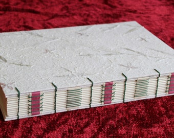 Special event / wedding photo album in handmade paper with flowers and grasses