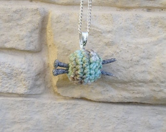 Jewelry pendant: small ball of yarn with knitting needles