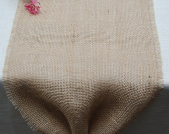 Natural burlap table runner with a burlap flower accent / bow and fringed edges. Simple, Rusic, Cottage Chic. Made to order.