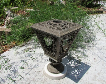 Beautiful vintage iron filigree candle stand on marble base