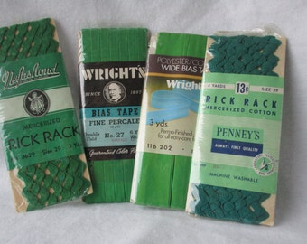 A lot of four sewing green sewing notions, bias tape, and rich rack