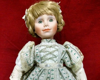 Nadine, a Dynasty Doll Collectible
